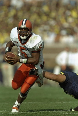 12 Sep 1998: Quarterback Donovan McNabb #5 of the Syracuse Orangeman grips the ball as he avoids being tackled during the game against Michigan Wolverines at Michigan Stadium in Ann Arbor, Michigan. Syracuse defeated Michigan 38-26.