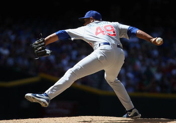 PHOENIX - APRIL 29:  Relief pitcher Carlos Marmol #49 of the Chicago Cubs pitches against the Arizona Diamondbacks during the game at Chase Field on April 29, 2009 in Phoenix, Arizona. The Diamondbacks defeated the Cubs 10-0.  (Photo by Christian Petersen