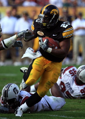 TAMPA, FL - JANUARY 01:  Shonn Green #23 of the Iowa Hawkeyes runs the ball against the South Carolina Gamecocks during the Outback Bowl on January 1, 2009 at Raymond James Stadium in Tampa, Florida.  (Photo by Scott Halleran/Getty Images)