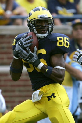 ANN ARBOR, MI - SEPTEMBER 23:  Mario Manningham #86 of the Michigan Wolverines catches a touchdown pass in the 2nd half against the Wisconsin Badgers on September 23, 2006 at Michigan Stadium in Ann Arbor, Michigan. Michigan defeated Wisconsin 27-13.  (Ph