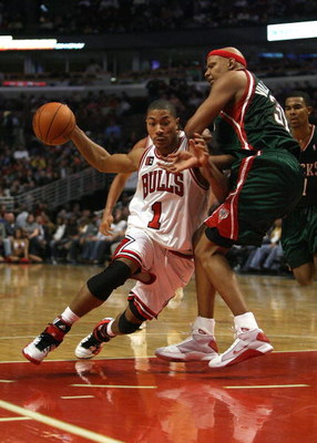 CHICAGO - MARCH 06:  Derrick Rose #1 of the Chicago Bulls drives against Charlie Villanueva #31 of the Milwaukee at the United Center on March 6, 2009 in Chicago, Illinois.  NOTE TO USER: User expressly acknowledges and agreees that, by downloading and/or