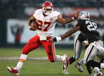 OAKLAND, CA - NOVEMBER 30:  Larry Johnson #27 of the Kansas City Chiefs runs against Gibril Wilson #28 of the Oakland Raiders during an NFL game on November 30, 2008 at the Oakland-Alameda County Coliseum in Oakland, California.  (Photo by Jed Jacobsohn/G