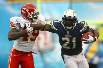 SAN DIEGO - NOVEMBER 9:  LaDainian Tomlinson #21 of the San Diego Chargers carries the ball against Bernard Pollard #49 of the Kansas City Chiefs at Qualcomm Stadium on November 9, 2008 in San Diego, California. (Photo by: Jeff Gross/Getty Images)