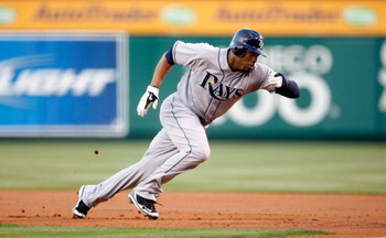 ANAHEIM, CA - AUGUST 10:  Carl Crawford #13 of the Tampa Bay Rays leads off first base against the Los Angeles Angels of Anaheim at Angel Stadium on August 10, 2009 in Anaheim, California.  (Photo by Jeff Gross/Getty Images)