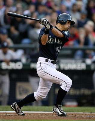 SEATTLE  - AUGUST 14:  Ichiro Suzuki #51 of the Seattle Mariners singles in the first inning against the New York Yankees on August 14, 2009 at Safeco Field in Seattle, Washington. (Photo by Otto Greule Jr/Getty Images)