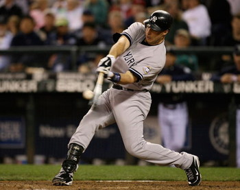 SEATTLE  - AUGUST 14:  Mark Teixeira #25 of the New York Yankees hits a solo home run in the ninth inning to take a 3-2 lead over the Seattle Mariners on August 14, 2009 at Safeco Field in Seattle, Washington. (Photo by Otto Greule Jr/Getty Images)