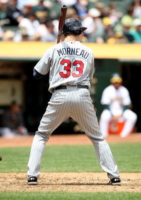 OAKLAND, CA - JUNE 11:  Justin Morneau #33 of the Minnesota Twins bats against the Oakland Athletics during a Major League Baseball game on June 11, 2009 at the Oakland Coliseum in Oakland, California.  (Photo by Jed Jacobsohn/Getty Images)