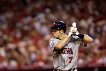 ST. LOUIS, MO - JULY 14:  American League All-Star Joe Mauer of the Minnesota Twins bats during the 2009 MLB All-Star Game at Busch Stadium on July 14, 2009 in St Louis, Missouri. (Photo by Jamie Squire/Getty Images)