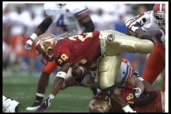 30 Nov 1996: Running back Warrick Dunn of the Florida State Seminoles moves the ball during a game against the Floirda Gators at Doak S. Campbell Stadium in Tallahassee, Florida. FSU won the game, 24-21.