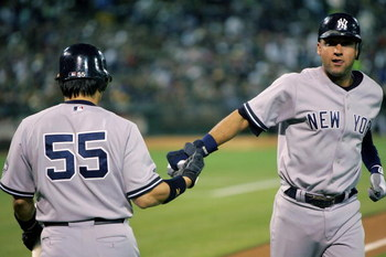 OAKLAND, CA - AUGUST 18: Derek Jeter #2 of the New York Yankees is congratulated by Hideki Matsui #55 after Jeter scored in the sixth inning of their game against the Oakland Athletics at the Oakland Colisuem on August 18, 2009 in Oakland, California.  (P
