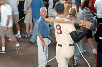 BOSTON, MA - JULY 22:  A man looks at a statue of Ted Williams during 'Ted Williams, A Celebration of an American Hero' day July 22, 2002 at Fenway Park in Boston, Massachusetts. The public was invited to the park to honor Williams who died July 5, 2002.