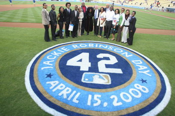LOS ANGELES - APRIL 15:  Actor Lou Cossett Jr., singer Chaka Khan and others pose for a photo during ceremonies honoring Jackie Robinson before the game between the Los Angeles Dodgers and the Pittsburgh Pirates on April 15, 2008 at Dodger Stadium in Los