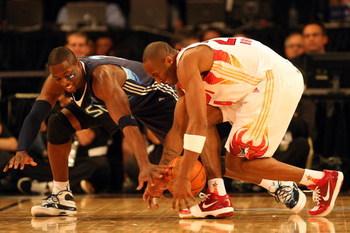 PHOENIX - FEBRUARY 15:  Dwyane Wade #3 of the Eastern Conference and Kobe Bryant #24 of the Western Conference go after a loose ball during the 58th NBA All-Star Game, part of 2009 NBA All-Star Weekend at US Airways Center on February 15, 2009 in Phoenix,