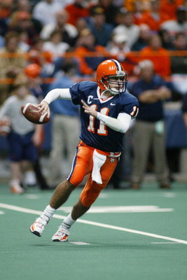 SYRACUSE, NY - NOVEMBER 30:  Quarterback Troy Nunes #11 of Syracuse University prepares to pass during the game against the University of Miami at the Carrier Dome on November 30, 2002 in Syracuse, New York. Miami won 49 to 7.   (Photo by Rick Stewart/Get