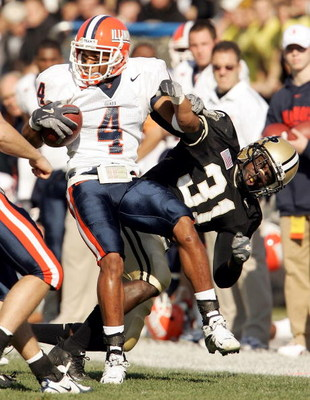 WEST LAFAYETTE, IN - NOVEMBER 12:  Head Derrick McPhearson #4 of the Illinois Fighting Illini is brought down by Bernard Pollard #31 on November 12, 2005 at Ross-Ade Stadium in St. West Lafayette, Indiana.  (Photo by Elsa/Getty Images)