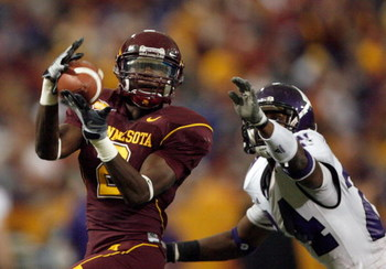 MINNEAPOLIS - NOVEMBER 01:  Brandon Green #2 of the Minnesota Golden Gophers makes a catch in front of Sherrick McManis #26 of the Northwestern Wildcats during the third quarter at the Hubert H.Humphrey Metrodome on November 1, 2008 in Minneapolis, Minnes