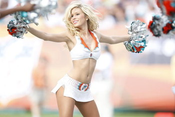 MIAMI - JANUARY 4:  A Miami Dolphins cheerleader performs during an AFC Wild Card playoff game against the Baltimore Ravens on January 4, 2009 at Dolphin Stadium in Miami, Florida. (Photo by Gregory Shamus/Getty Images)