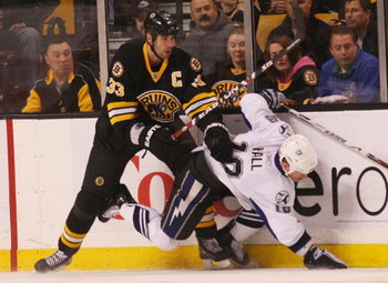 BOSTON - MARCH 31: Adam Hall #18 of the Tampa Bay Lightning is hit by Zdeno Chara #33 of the Boston Bruins on March 31, 2009 at the TD Banknorth Garden in Boston. (Photo by Bruce Bennett/Getty Images)