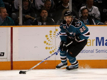SAN JOSE, CA - APRIL 25:  Dan Boyle #22 of the San Jose Sharks controls the puck against the Anaheim Ducks during Game Five of the Western Conference Quarterfinal Round of the 2009 NHL Stanley Cup Playoffs at HP Pavilion on April 25, 2009 in San Jose, Cal