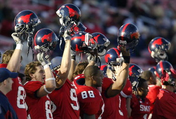 DALLAS - NOVEMBER 29:  Members of the Southern Methodist University Mustangs cheer the start of the second half against the Texas Christian University Horned Frogs despite looking at an 0-11 season November 29, 2003 at Gerald J. Ford Stadium in Dallas, Te