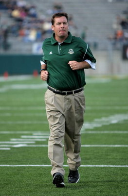 FORT COLLINS, CO - NOVEMBER 01:  Head coach Steve Fairchild of the Colorado State Rams leads his team against the Brigham Young Cougars at Sonny Lubick Field at Hughes Stadium on November 1, 2008 in Fort Collins, Colorado. BYU defeated CSU 45-42.  (Photo