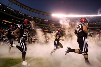 SAN DIEGO - AUGUST 31:  The San Diego State Aztecs enter the stadium against the UTEP Miners during the first half of their NCAA Football Game at Qualcomm Stadium on August 31, 2006 in San Diego, California.  (Photo by Donald Miralle/Getty Images)
