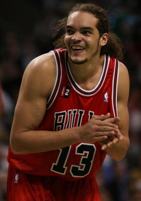 BOSTON - MAY 02:  Joakim Noah #13 of the Chicago Bulls reacts as the Boston Celtics fans yell at him in Game Seven of the Eastern Conference Quarterfinals during the 2009 NBA Playoffs at TD Banknorth Garden on May 2, 2009 in Boston, Massachusetts. The Cel