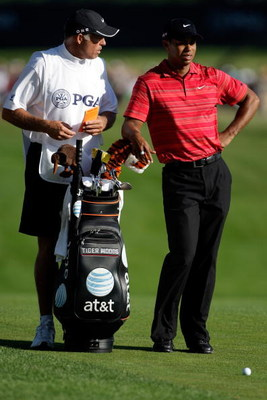 CHASKA, MN - AUGUST 16:  Tiger Woods (R) waits with his caddie Steve Williams during the final round of the 91st PGA Championship at Hazeltine National Golf Club on August 16, 2009 in Chaska, Minnesota.  (Photo by Jamie Squire/Getty Images)