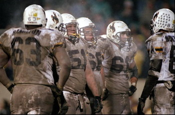 7 Nov 1998:  Members of the Wyoming Cowboys look on during a game against the Colorado State Rams at the Hughes Stadium in Ft. Collins, Colorado. The Cowboys defeated the Rams 27-19. Mandatory Credit: Brian Bahr  /Allsport