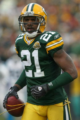 GREEN BAY - NOVEMBER 18:  Charles Woodson #21 of the Green Bay Packers carries the ball during the NFL game against the Carolina Panthers at Lambeau Field on November 18, 2007 in Green Bay, Wisconsin. (Photo by Jonathan Daniel/Getty Images)