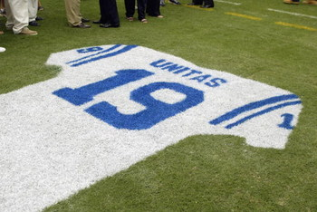 BALTIMORE - SEPTEMBER  15:  Detail of an onfield tribute to Hall of Fame quarterback Johnny Unitas #19 of the Baltimore Colts during halftime of the NFL game between the Tampa Bay Buccaneers and the Baltimore Ravens on September 15, 2002 at Ravens Stadium