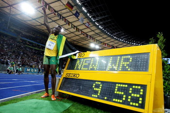 BERLIN - AUGUST 16:  Usain Bolt of Jamaica celebrates winning the gold medal in the men's 100 Metres Final during day two of the 12th IAAF World Athletics Championships at the Olympic Stadium on August 16, 2009 in Berlin, Germany. Bolt set a new World Rec