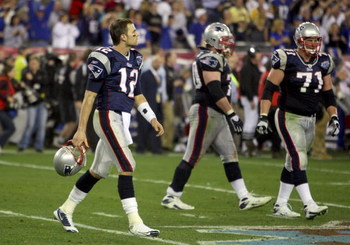 GLENDALE, AZ - FEBRUARY 03:  Tom Brady #12 of the New England Patriots walks off the field during Super Bowl XLII against the New York Giants on February 3, 2008 at the University of Phoenix Stadium in Glendale, Arizona.  (Photo by Donald Miralle/Getty Im