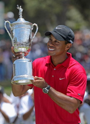 SAN DIEGO - JUNE 16:  Tiger Woods celebrates with the trophy after winning on the first sudden death playoff hole during the playoff round of the 108th U.S. Open at the Torrey Pines Golf Course (South Course) on June 16, 2008 in San Diego, California.  (P