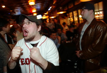 NEW YORK - OCTOBER 20:  Boston Red Sox fan Zalman Abranchik (L) celebrates while a Yankees fan stands stunned in the Amsterdam Inn in the Upper West Side October 20, 2004 in New York City.  (Photo by Chris Hondros/Getty Images)