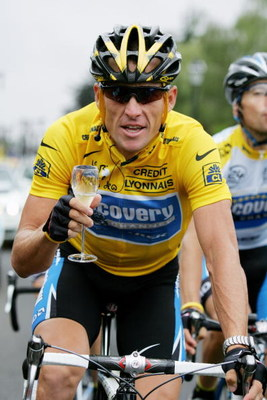 PARIS - JULY 24:  Lance Armstrong of the USA riding for the Discovery Channel team has a glass of champange on his way to winning a seventh consecutive Tour de France during Stage 21 of the Tour de France between Montereau and The Champs Elysees on July 2