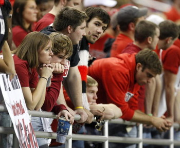 DETROIT - DECEMBER 05: Fans of the Ball State Cardinals react after a fourth quarter touchdown by the Buffalo Bulls in the MAC Championship game on December 5, 2008 at Ford Field in Detroit, Michigan. (Photo by Gregory Shamus/Getty Images)
