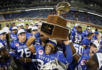 DETROIT - DECEMBER 05: Mike Newton #30 of the Buffalo Bulls celebrates the MAC Championship with teammates after defeating the Ball State Cardinals on December 5, 2008 at Ford Field in Detroit, Michigan. (Photo by Gregory Shamus/Getty Images)