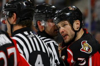 OTTAWA - FEBRUARY 19:  Jarkko Ruutu #73 of the Ottawa Senators has words with referee Wes McCauley #4  in a game against the Vancouver Canucks on February 19, 2009 at the Scotiabank Place in Ottawa, Canada. (Photo by Phillip MacCallum/Getty Images)