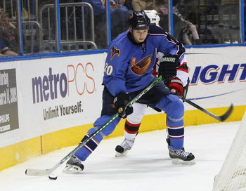 ATLANTA - FEBRUARY 06: Colby Armstrong #20 of the Atlanta Thrashers skates against the New Jersey Devils on February 6, 2009 at the Philips Arena in Atlanta, Georgia. (Photo by Bruce Bennett/Getty Images)