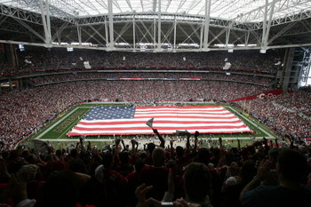 GLENDALE, AZ - JANUARY 18:  An American flag covers the field before the start of the NFC championship game between the Arizona Cardinals and the Philadelphia Eagles on January 18, 2009 at University of Phoenix Stadium in Glendale, Arizona.  (Photo by Rob