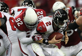 GLENDALE, AZ - JANUARY 03:  Quarterback Matt Ryan #2 of the Atlanta Falcons is sacked by Bertrand Berry #92 of the Arizona Cardinals during the NFC Wild Card Game on January 3, 2009 at University of Phoenix Stadium in Glendale, Arizona. The Cardinals defe