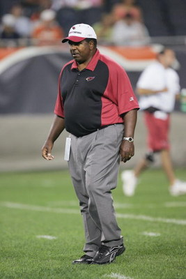 CHICAGO - AUGUST 25:  Head coach Dennis Green of the Arizona Cardinals walks on the field before a preseason game against the Chicago Bears on August 25, 2006 at Soldier Field in Chicago, Illinois. The Cardinals defeated the Bears 23-16. (Photo by Jonatha