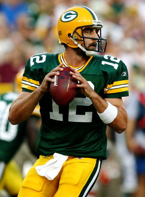 GREEN BAY, WI - AUGUST 15:  Quarterback Aaron Rodgers #12 of the Green Bay Packers looks to pass the ball in the first quarter against the Cleveland Browns during the preseason game at Lambeau Field on August 15, 2009 in Green Bay, Wisconsin. (Photo by Jo