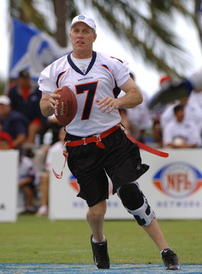 John Elway sets to  pass during an alumni air it out flag football game February 10 before  the 2006 Pro Bowl in Honolulu.  (Photo by Al Messerschmidt/Getty Images)