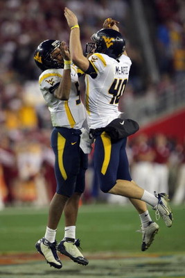 GLENDALE, AZ - JANUARY 02:  (L-R) Quarterback Patrick White #5 of the West Virginia Mountaineers and kicker Pat McAfee #40 celebrate the 79-yard touchdown catch thrown by White to Tito Gonzales #83 in the fourth quarter against the Oklahoma Sooners at the