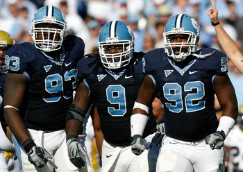 CHAPEL HILL, NC - NOVEMBER 08:  Cam Thomas #93, Marvin Austin #9 and E.J. Wilson #92 of the North Carolina Tar Heels celebrate after a defensive stop against the Georgia Tech Yellow Jackets during the game at Kenan Stadium on November 8, 2008 in Chapel Hi