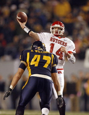 MORGANTOWN, WV - DECEMBER 2: Quarterback Mike Teel #14 of the Rutgers Scarlet Knights passes the ball against Reed Williams #47 of the West Virginia Mountaineers at Milan Puskar Stadium December 2, 2006 in Morgantown, West Virginia. West Virgina won the g