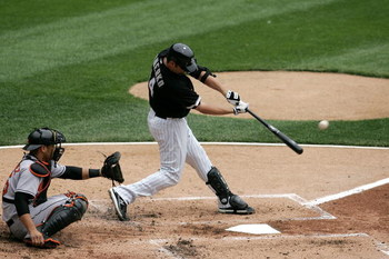 CHICAGO - APRIL 27:  Paul Konerko #14 of the Chicago White Sox hits a solo home run in the bottom of the second inning to give the White Sox a 1-0 lead against the Baltimore Orioles on April 27, 2008 at U.S. Cellular Field in Chicago, Illinois.  (Photo by