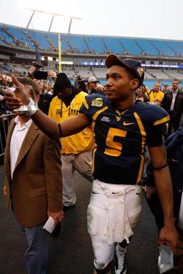 CHARLOTTE, NC - DECEMBER 27:  Pat White #5 of the West Virginia Mountaineers celebrates after defeating the North Carolina Tar Heels 31-30 after the Meineke Car Care Bowl on December 27, 2008 at Bank of America Stadium in Charlotte, North Carolina.  (Phot